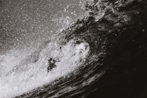 gray scale photo of stormy sea with large waves