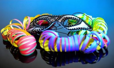 Masquerade mask with brightly colored ribbons