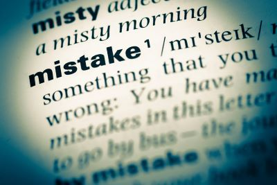 Close up photo of a dictionary entry with the word mistake and its definition